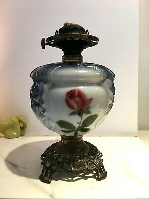 antique blue pink flowers oil lamp on a open fretwork base