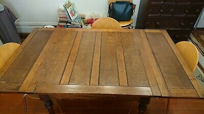 Antique dining table with 5 chairs. Square with extending leaves. Seats 4 to 8.