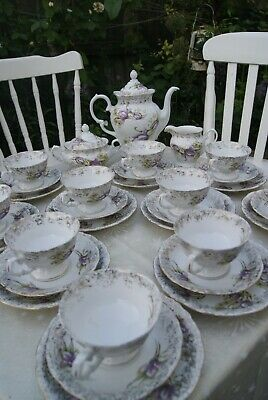 36 piece Wawel Tea set with dainty purple flowers and gold colour decoration.