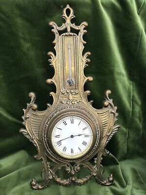 Vintage antique wall clock in brass