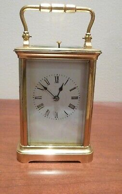 A Fine Antique  Repeating Carriage Clock On A Gong