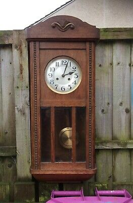 large antique wall clock. Working. has pendulum and key. Good glass condition