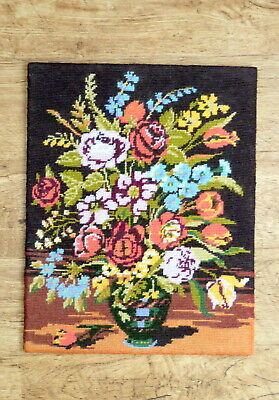 completed wool tapestry of flowers