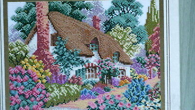 completed needlepoint work - cross stitch of cottage = framed