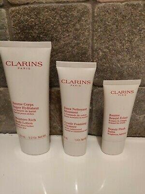 Clarins gift set unused beauty flash balm, foaming cleanser and rich body lotion