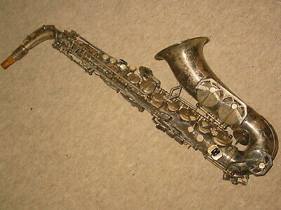 "old Alto saxophone with a finetuner ""Dolnet Paris, Made in France"""
