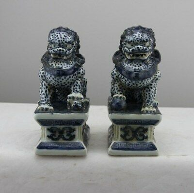Chinese Old Pair Marked Blue And White Porcelain Foo Dogs Statues.
