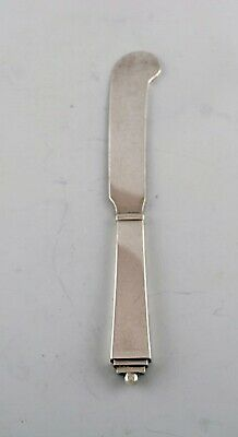 """Georg Jensen """"Pyramid"""" butter knife in all silver."""