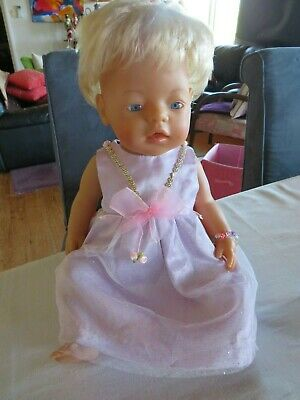 Zapf Baby Born doll with hair and cute outfit