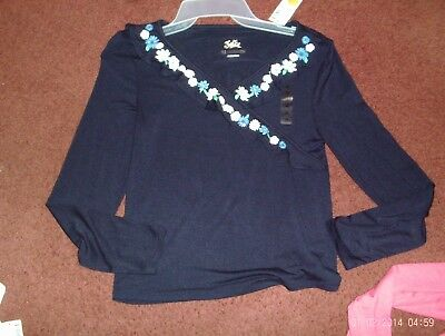 justice   girls size  12 --navy blue top---ruffled faux wrap ---glittery flowers