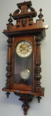 Art nouveau antique chiming wall clock.By B.A.36 inches by 14 inches.