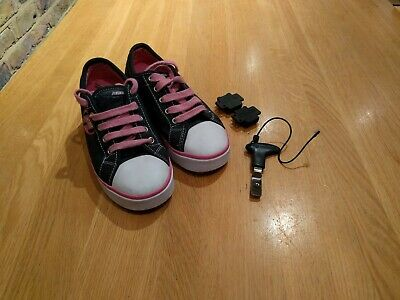 Girls Pink and Black Heelys Size 2 UK / 34.  Good condition.