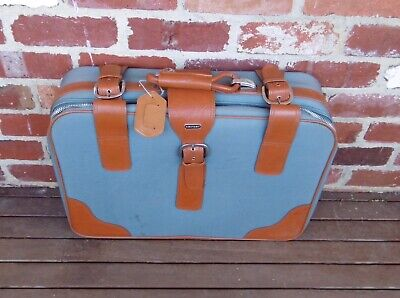 Two vintage matching blue suitcases