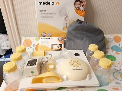 Medela Swing Electric Single Breast Pump bundle with bottles and extras