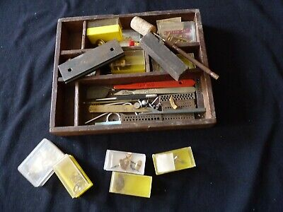 Wooden tray of vintage clock parts and tools
