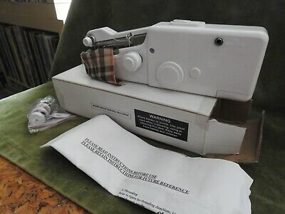 Hand Held Sewing Machine Battery Operated Never used.