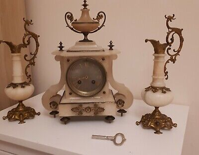 A French alabaster gilt mounted Mantel Clock