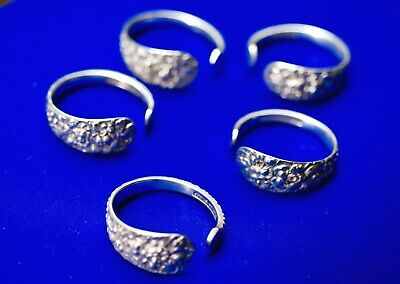 Fabulous Sterling Silver Repousse Set of 5 Napkin Rings by STIEFF