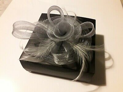 Boxed ladies fascinator silver/grey clip on. used once at wedding.