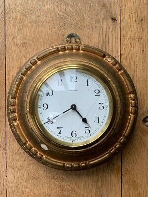 French 8 day lever movement wall clock. Gold coloured wooden case