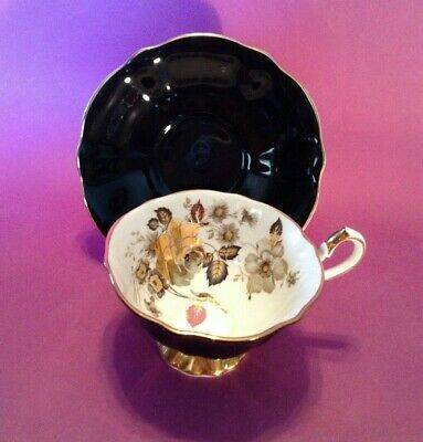 Queen Anne Pedestal Teacup & Saucer - Black With Brilliant Gold Roses - England