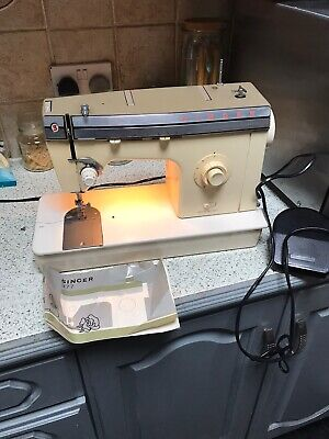 electric  Singer Sewing Machine 377 WITH Foot Pedal looks great