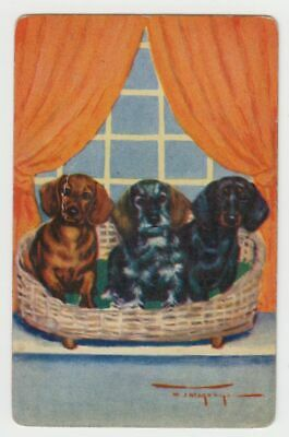 A293  Vintage  Playing Card Dog Artist card of 3 dachshunds in a basket