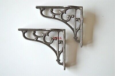 A pair of small Victorian scrolled cast iron brackets 4 inch wall shelf bracket