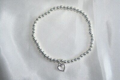 Silver Plated Stretch Beaded Bracelet with Open Heart Charm