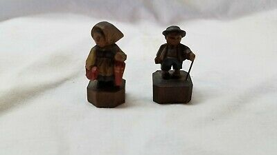 Vintage hand carved gentleman and wife.