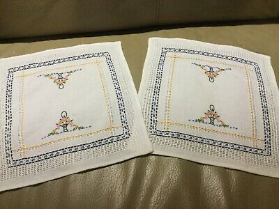 2 vintage hand embroidered doilies