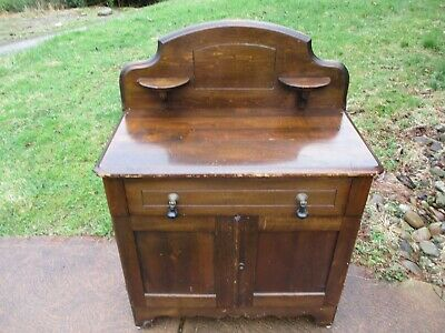 antique wash stand with candlestand backsplash