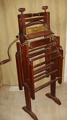 Antique wringer hand crank with double folding bench stand