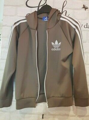 Girls green hooded Adidas tracksuit top  age 11 - 12    {649}