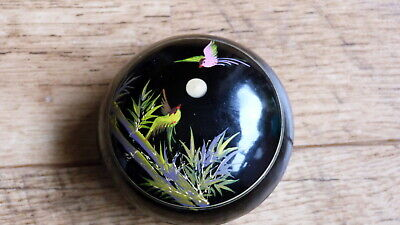 small oriental black lidded box with hand painted image of birds