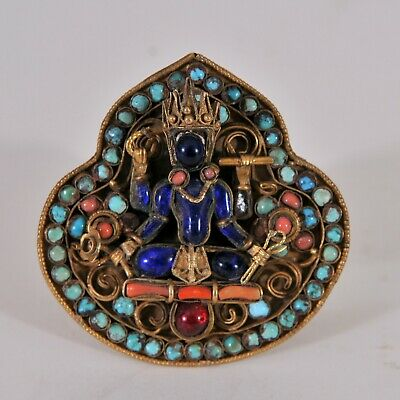 Antique Tibetian brooch, decorated with a Four handed Goddess