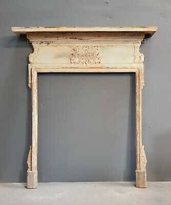 "Small ""shabby"" Cast fire surround with an original tatty paint finish"