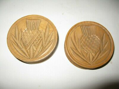 A Pair Of Simply Carved Thistle Design Butter Presses