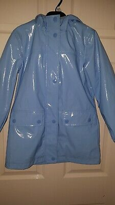 Girls Next blue hooded rain jacket / coat. Age 9