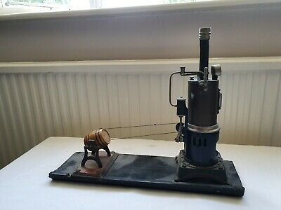 Toy steam engine with butter churn.