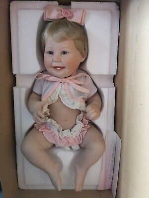 Ashton-Drake Galleries Porcelain 'Cute As A Button Baby' doll with certificate