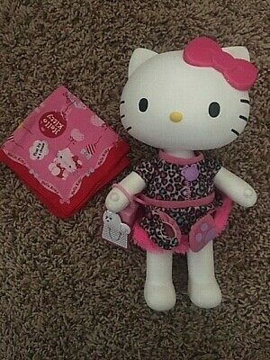HELLO KITTY by SANRIO 2013 HARD PLASTIC DOLL w/HEARTS DRESS, MITTS, BAG, SCARF