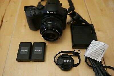 Samsung NX20 with 20-50mm lens and 2 batteries