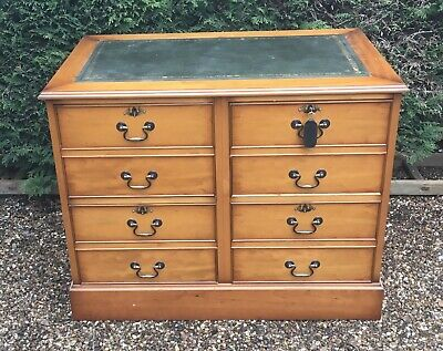 Yew wood filing drawers/ desk with green leather top