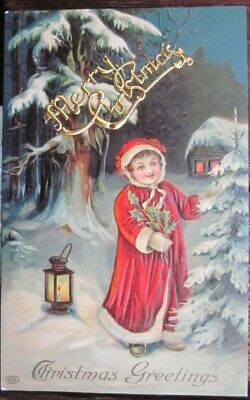 MERRY CHRISTMAS GIRL IN BRIGHT RED ROBE STANDING BY TREE NEXT TO LANTERN Germany