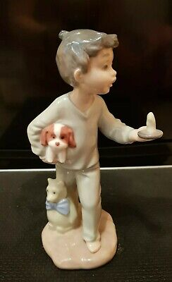 """NAO by Lladro Figurine: Boy Holding a Candle with Puppy And Teddy. 8"""" tall"""
