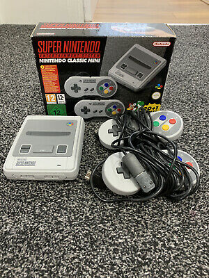 Official SNES mini - brilliant condition with free controller extenders