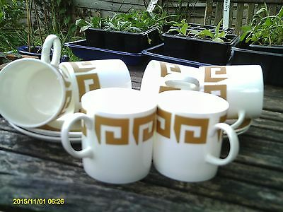 Wedgewood 'Susie Cooper design' OLD GOLD coffee cans and saucers