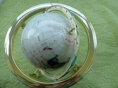 Gemstone style globe in rotating cradle with compass