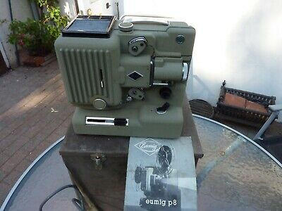 Vintage Eumig P8 cine projector with case and instruction booklet.